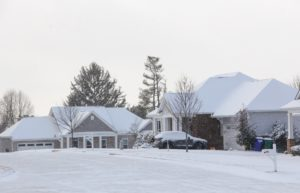 Homes & neighborhoods houses covered with snow after cold winter snow storm